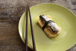 12370   tamagoyaki with fish on green plate