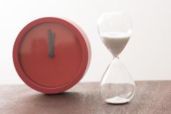 12961   Modern red timer clock with an egg timer