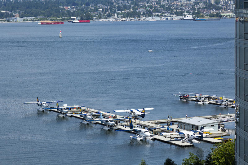 <p>Sky planes in the jetty - downtown Vancouver at Coal Harbour</p>