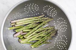 13038   Washing fresh green asparagus spears