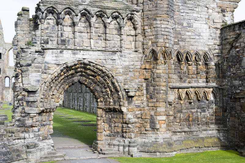 Ancient Gothic arch and the remnants of an old medieval stone wall , St Andrews Cathedral ruins, St Andrews, Scotland