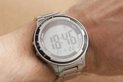 11904   Silver electronic watch on the wrist of a man