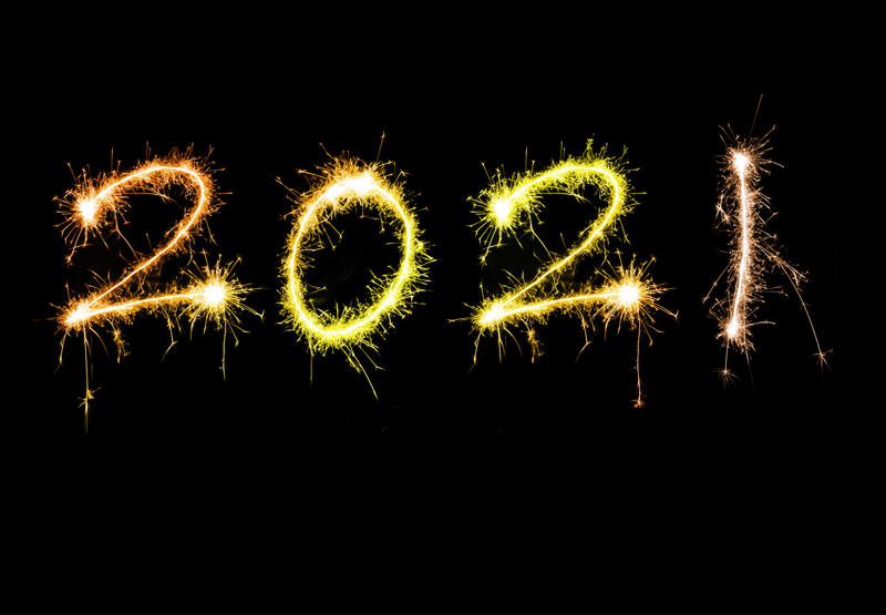 New years 2021 sparkling sign with golden orange digits floating isolated against black background