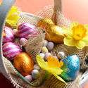 17331   Basket of easter eggs, decorated with daffodils
