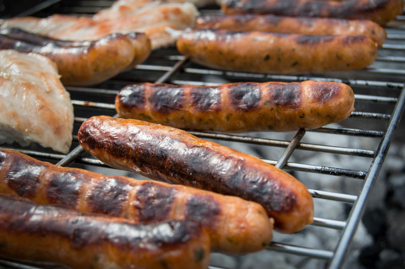 <p>BBQ grill with sausages</p>
