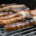 17423   Grilling sausages on a barbecue