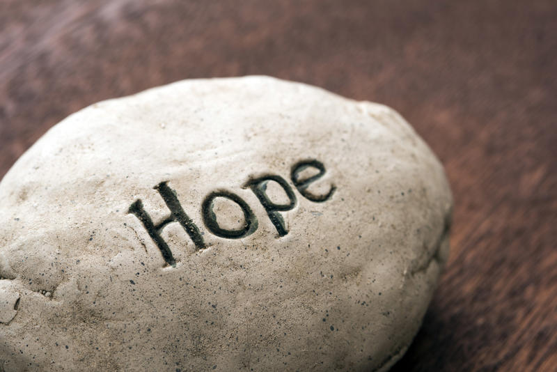 The word Hope incised onto resin or stone in an inspirational concept for the coronavirus pandemic