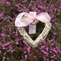 stock image 17362   Rustic hand crafted wicker heart on pink heather