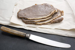 17266   Sliced roast beef on paper and kitchen knife