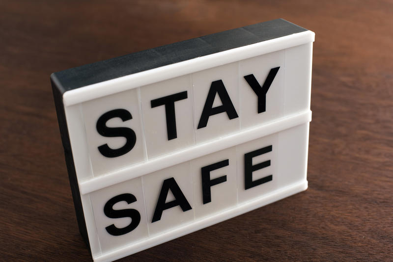 Small Stay Safe sign on a table or floor urging people to take care during the Covid-19 pandemic