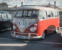 17381   Orange VW camper van from 1960's.