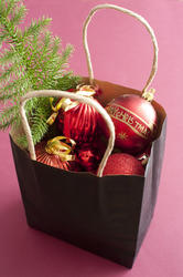 17292   Paper carrier bag full of Christmas decorations