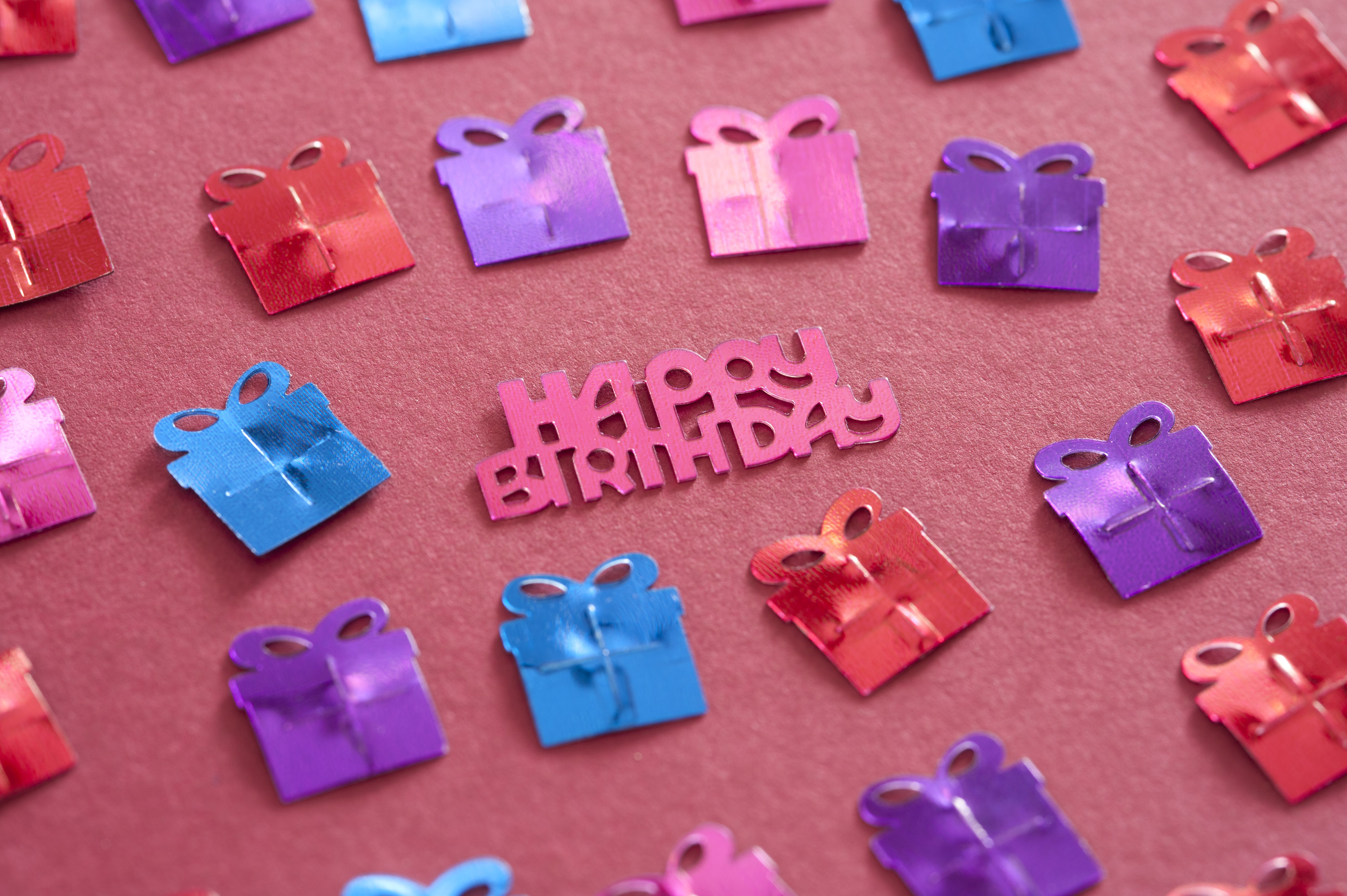 Happy Birthday Festive Background With Small Gift Decorations And Pink Text For A Girl On