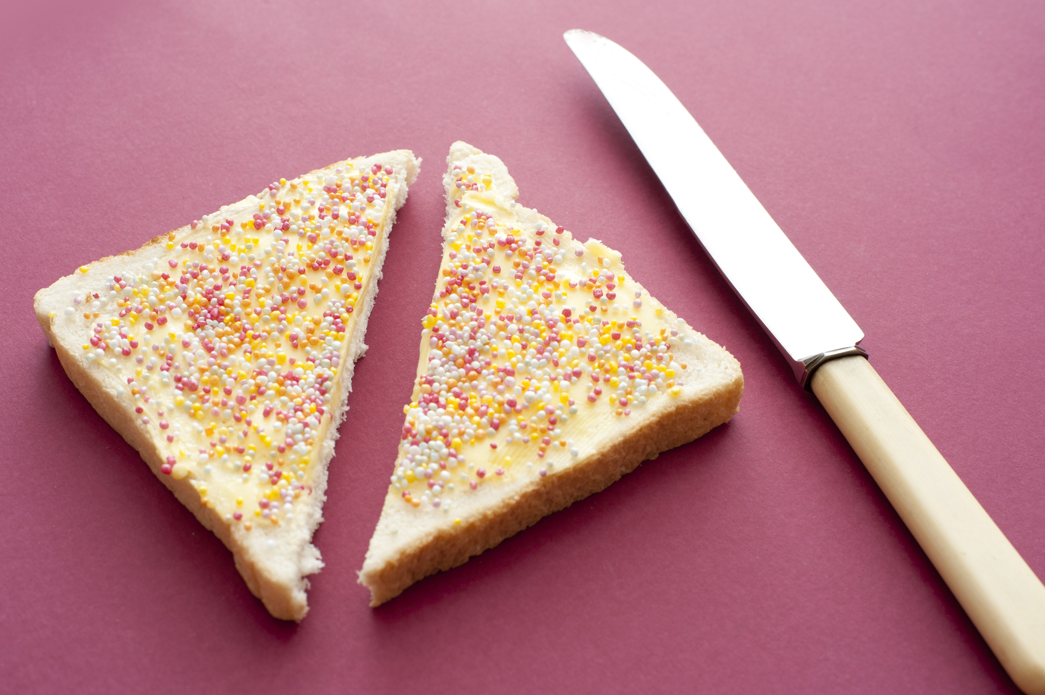 free stock photo 12755 fairybread cut in half with knife