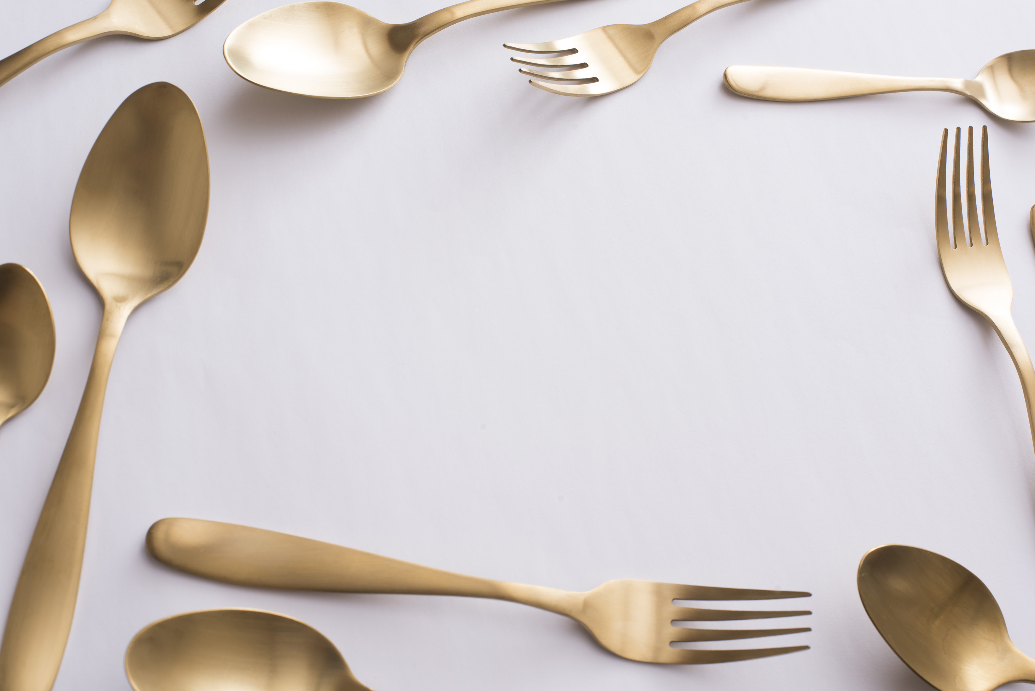 Food or catering frame with assorted cutlery spoons and forks around a central white & Free Stock Photo 13101 Food or catering frame with assorted cutlery ...