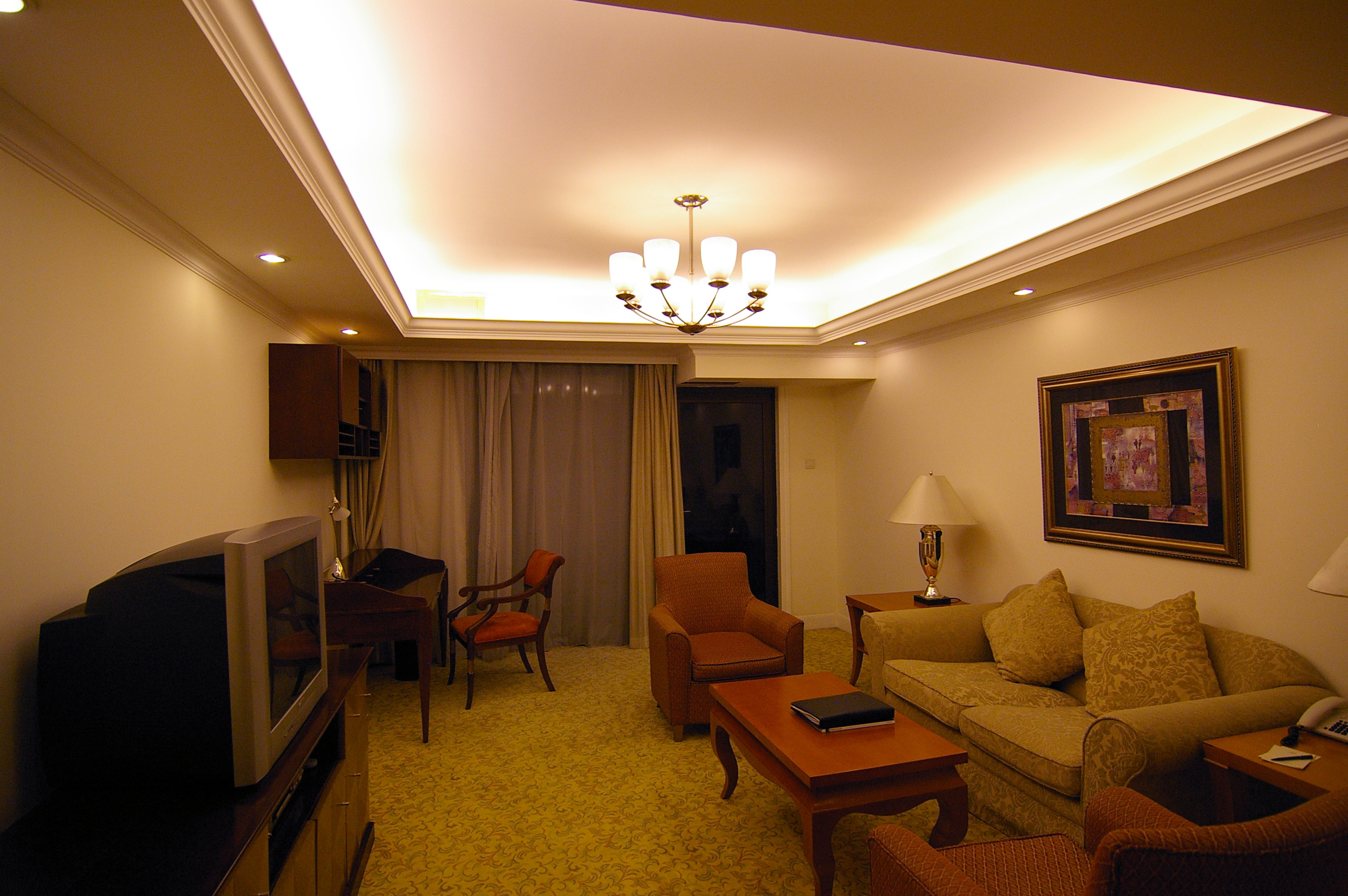 A Living Room In High Rise Apartment At Night Soft Chairs Tv And