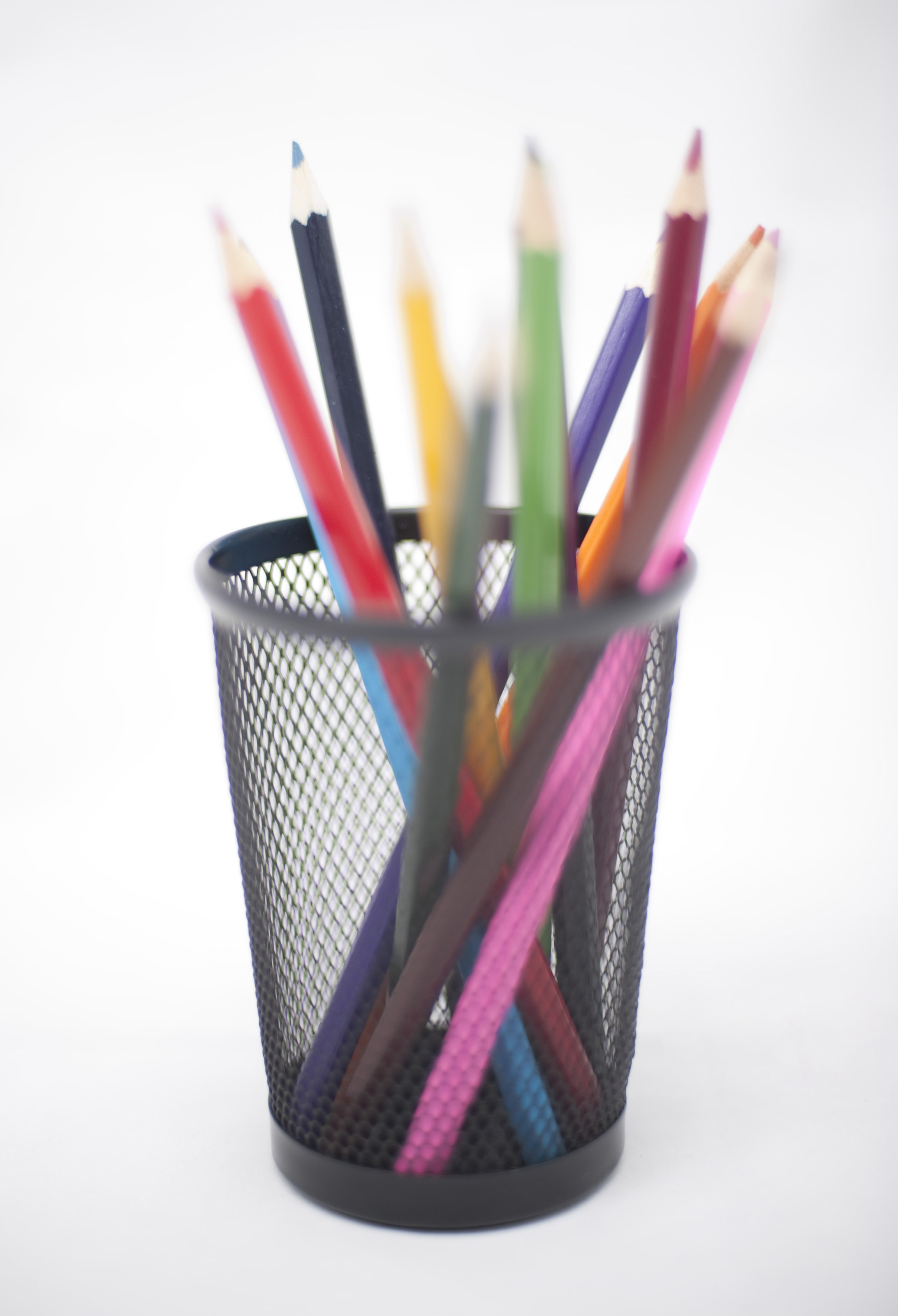 Colored pencils in black pencil basket - pictured with a shallow DOF
