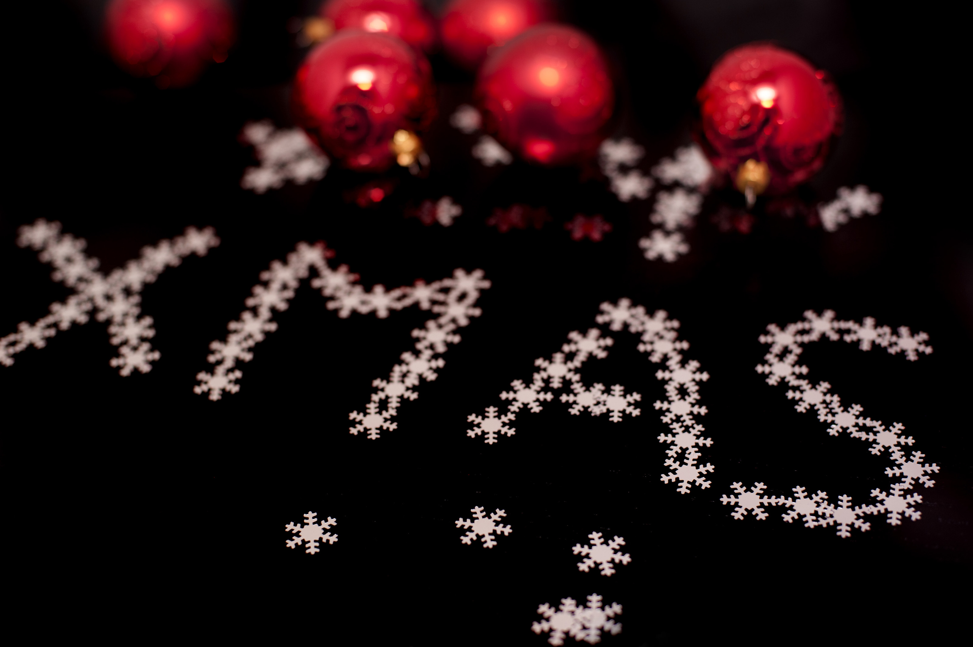 Free stock photo 6836 decorative xmas greeting freeimageslive decorative xmas greeting with tiny little white snaowflakes and red christmas baubles on a black background voltagebd Gallery