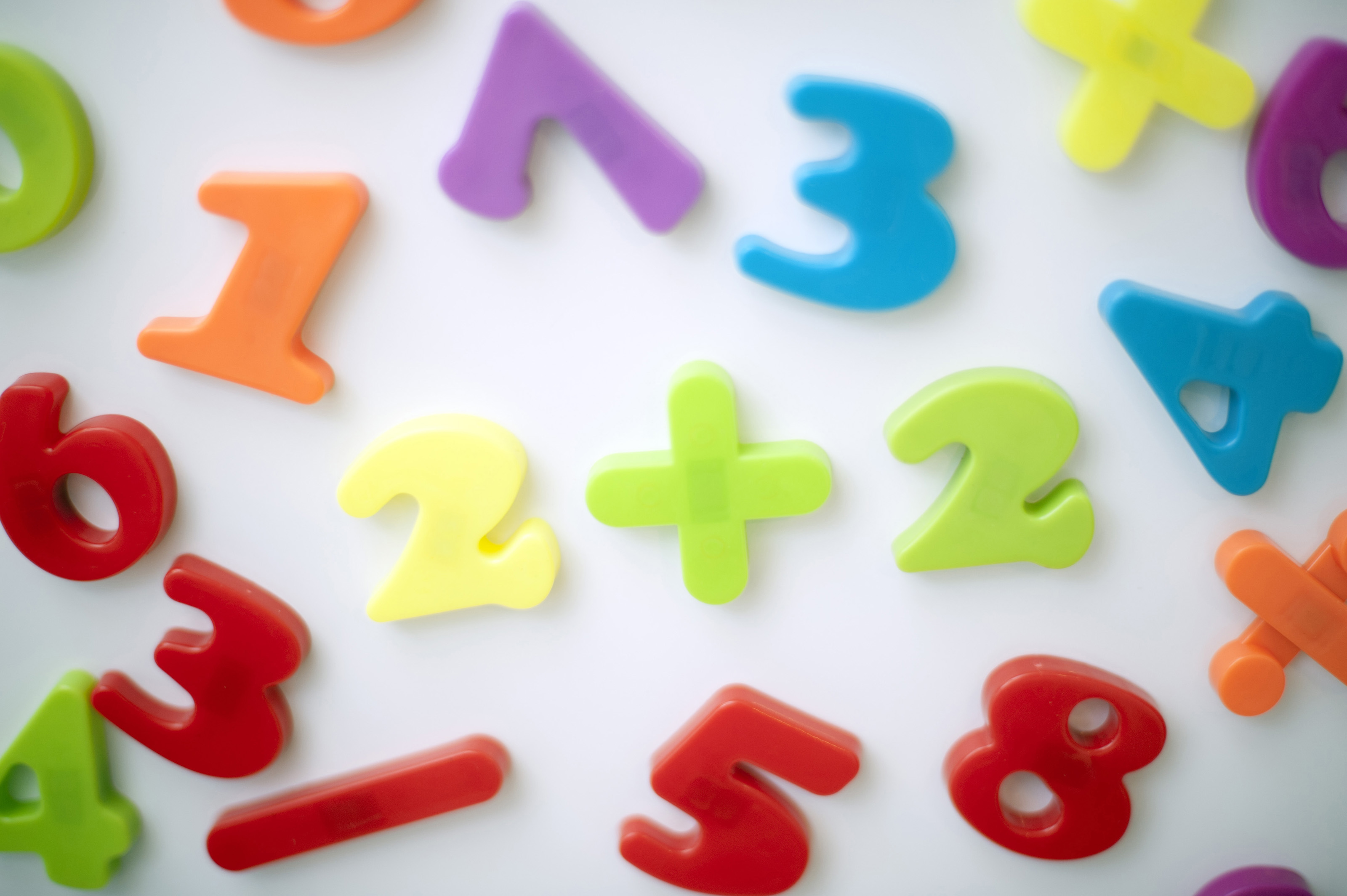 Free stock photo 6996 learning maths with colourful numbers learning maths with colourful plastic numbers and mathematical symbols scattered on a white background biocorpaavc Choice Image
