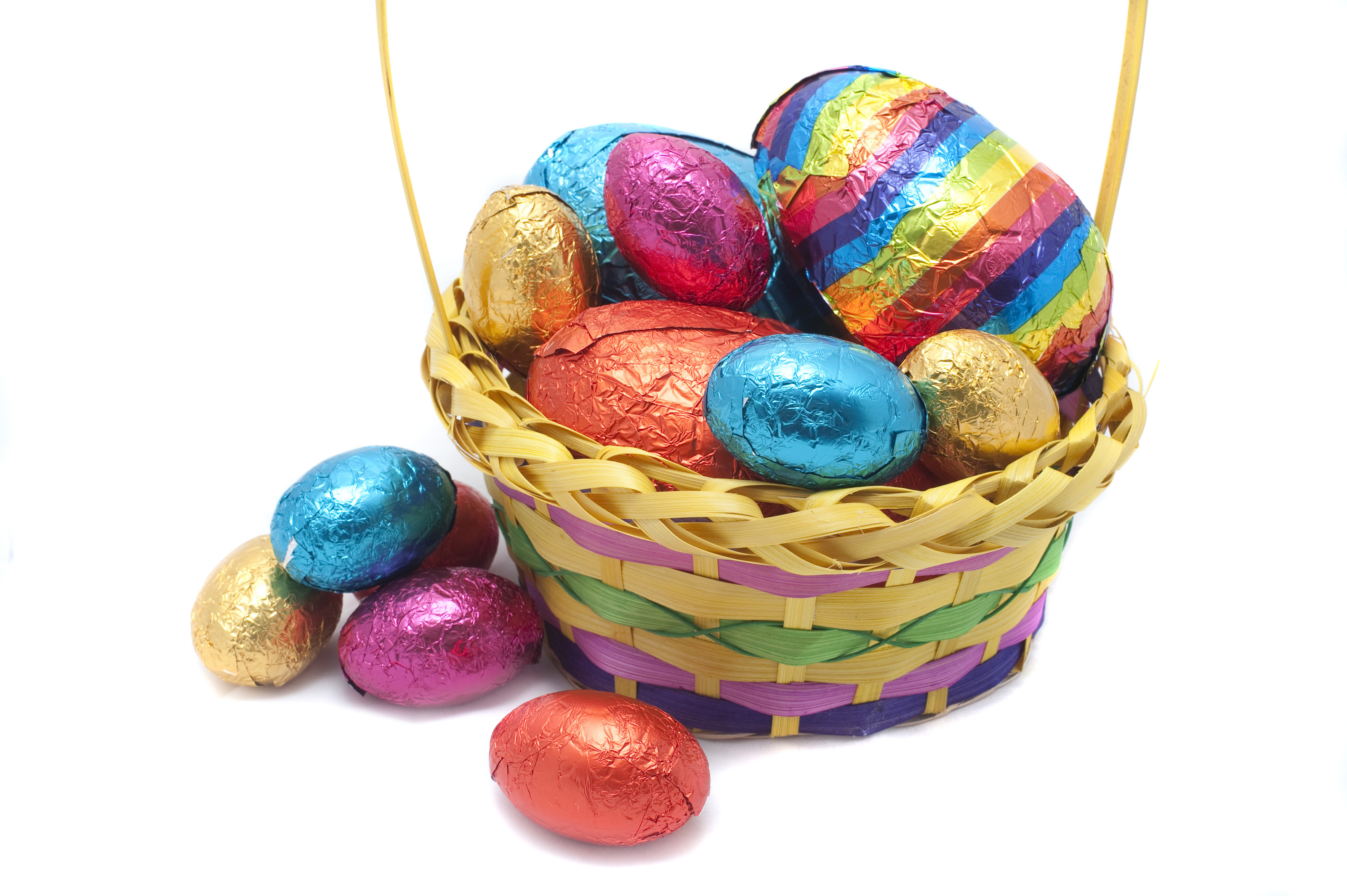 Free stock photo 7889 basket of easter eggs freeimageslive decorative basket of easter eggs in assorted sizes and colours on a white studio background negle Choice Image
