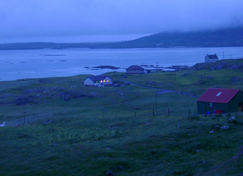a nightscape in the scottish islands, and small house overlooking the bay