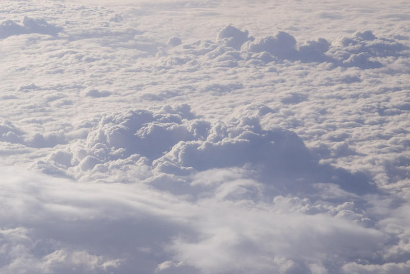 view of clouds from an aeroplane window