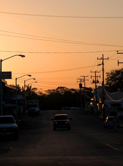 sunset silhouette in a mexican street