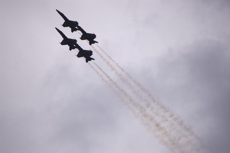 US navy blue angles flying in formation with smoke trails