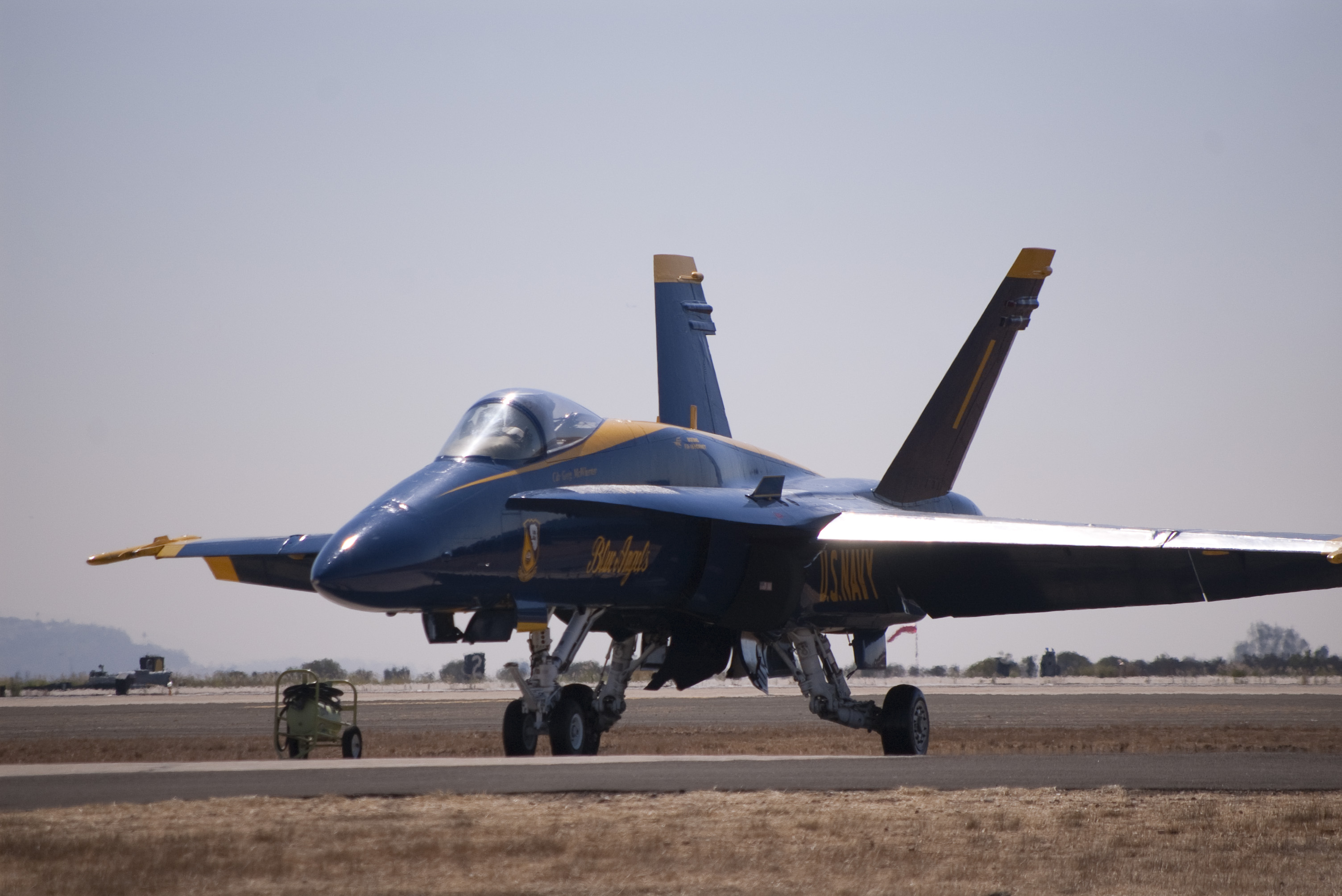 a blue angels hornet sat on the air field