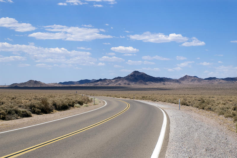 on the road again: a scenic landscape from a drive through the california desert