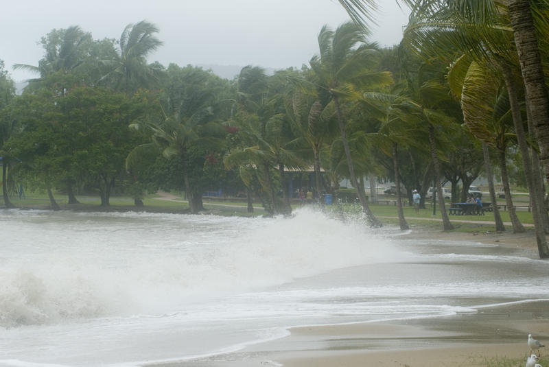 strong winds blowing waves onto a tropical beach
