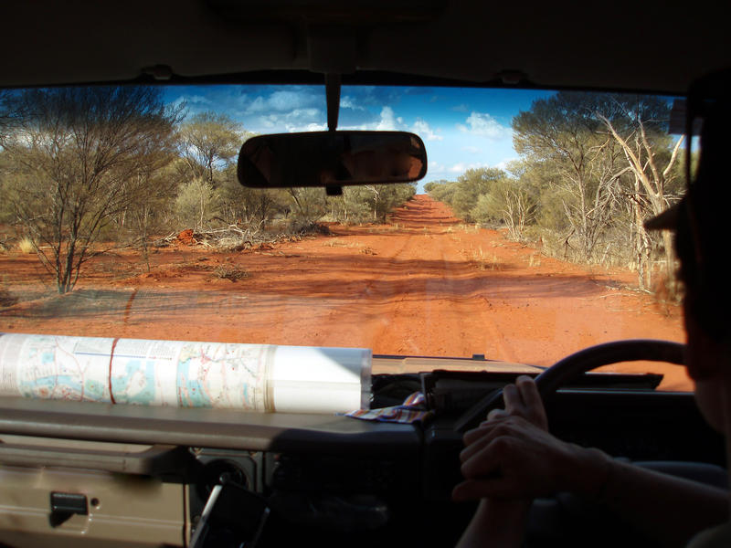 driving along a red dirt road in australias northern territory