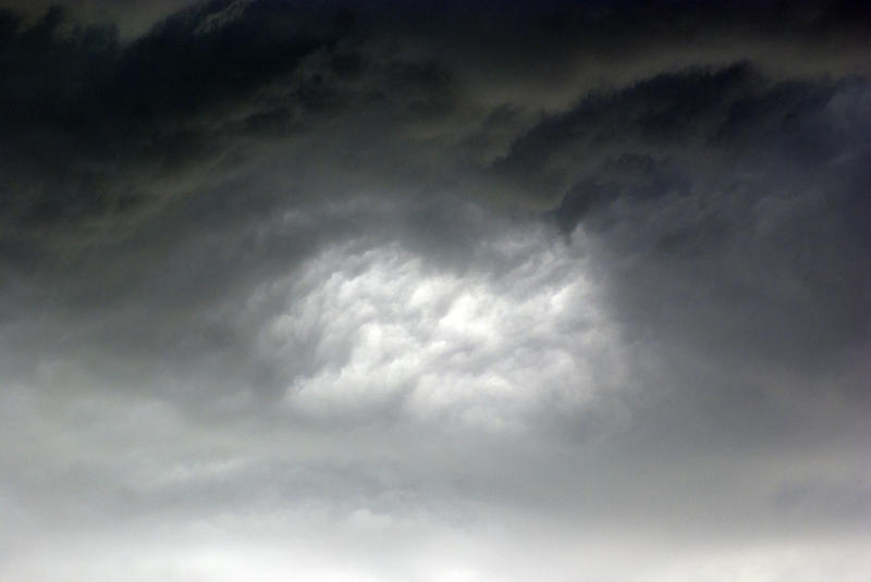 <p>Bright spot in storm clouds</p>Hole inside storm clouds