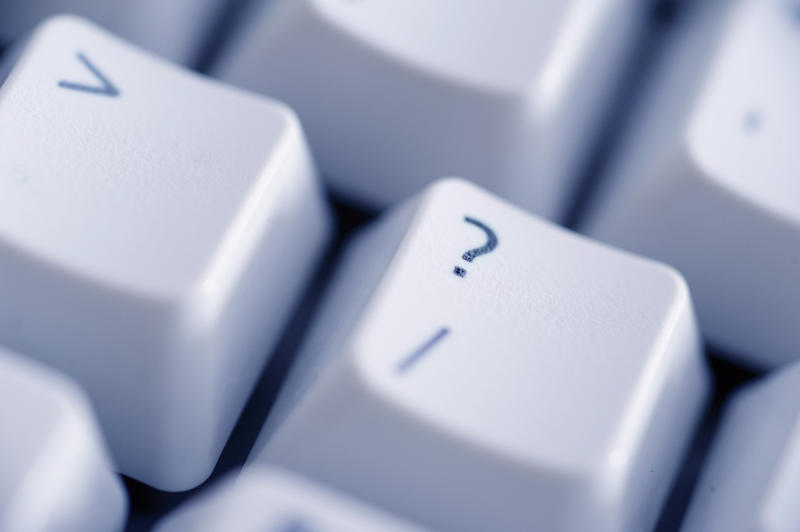 close up on the question key on a computer keyboard.