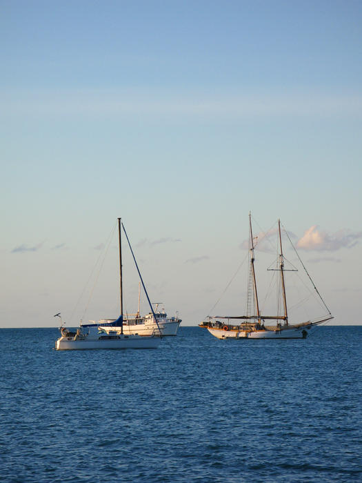 a schooner rigged boat and a modern bermuda rigged sloop yacht
