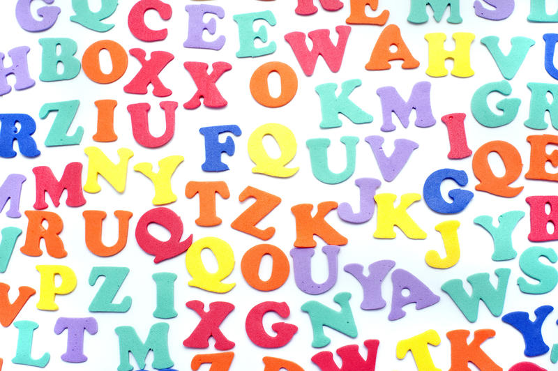 Array of colourful alphabet letters in uppercase on a white background for teaching children languages