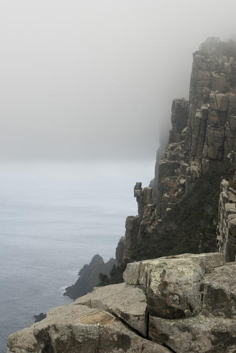 spectacular rugged coastline of cape pillar pictured on a misty day
