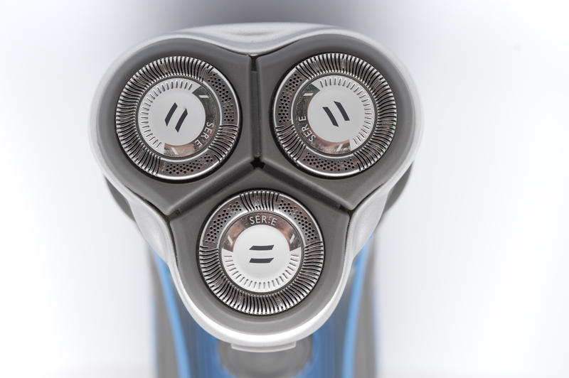 Electric shaver detail with a closeup of the head and blades