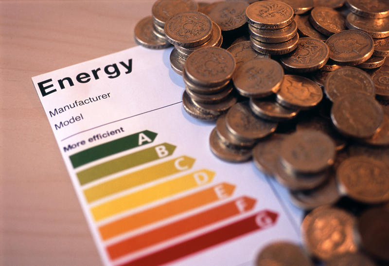 concept image of an appliance energy efficience rating label and a pile of uk money