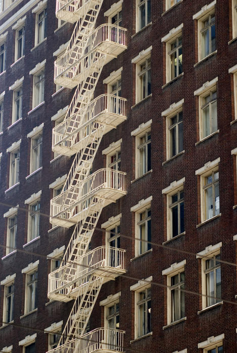external fire escape stairs on the side of a tall building in san francisco