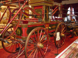 6677   Antique red fire pump engine