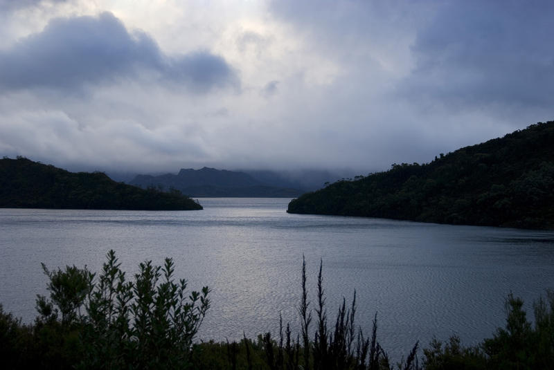 dramatic stormy clouds over lake pedder, tasmania
