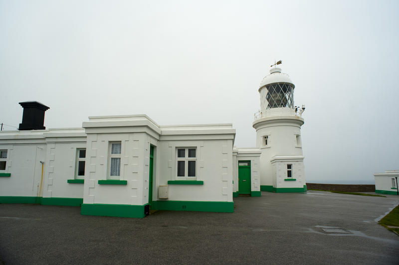 lighthouse and watchmans cottages in the traditional trinity style, pendeen cornwall