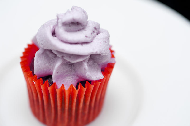 close up image of a small iced cup cake