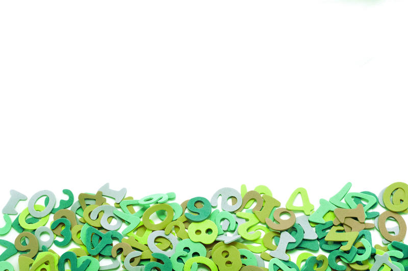 Random pile of colourful green numbers forming a lower border against a white background with copyspace for your text