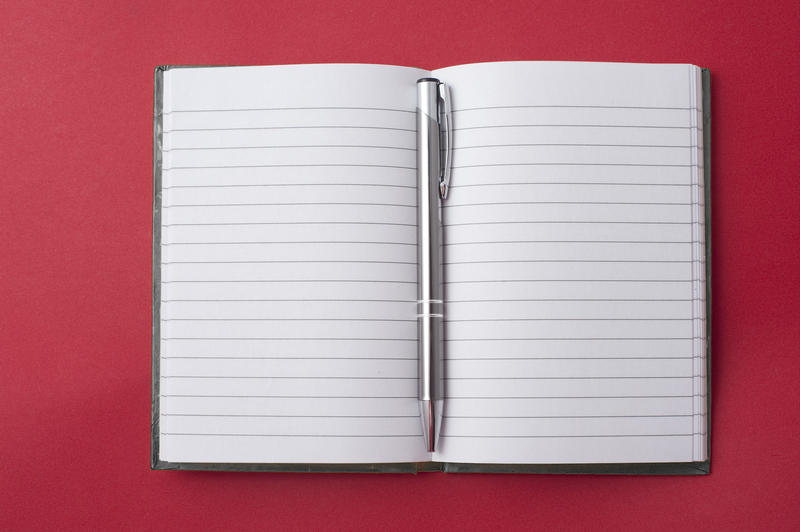 5363   Opened notebook with a pen in the centre