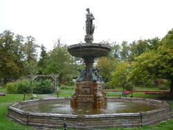 6779   Figural fountain in formal garden