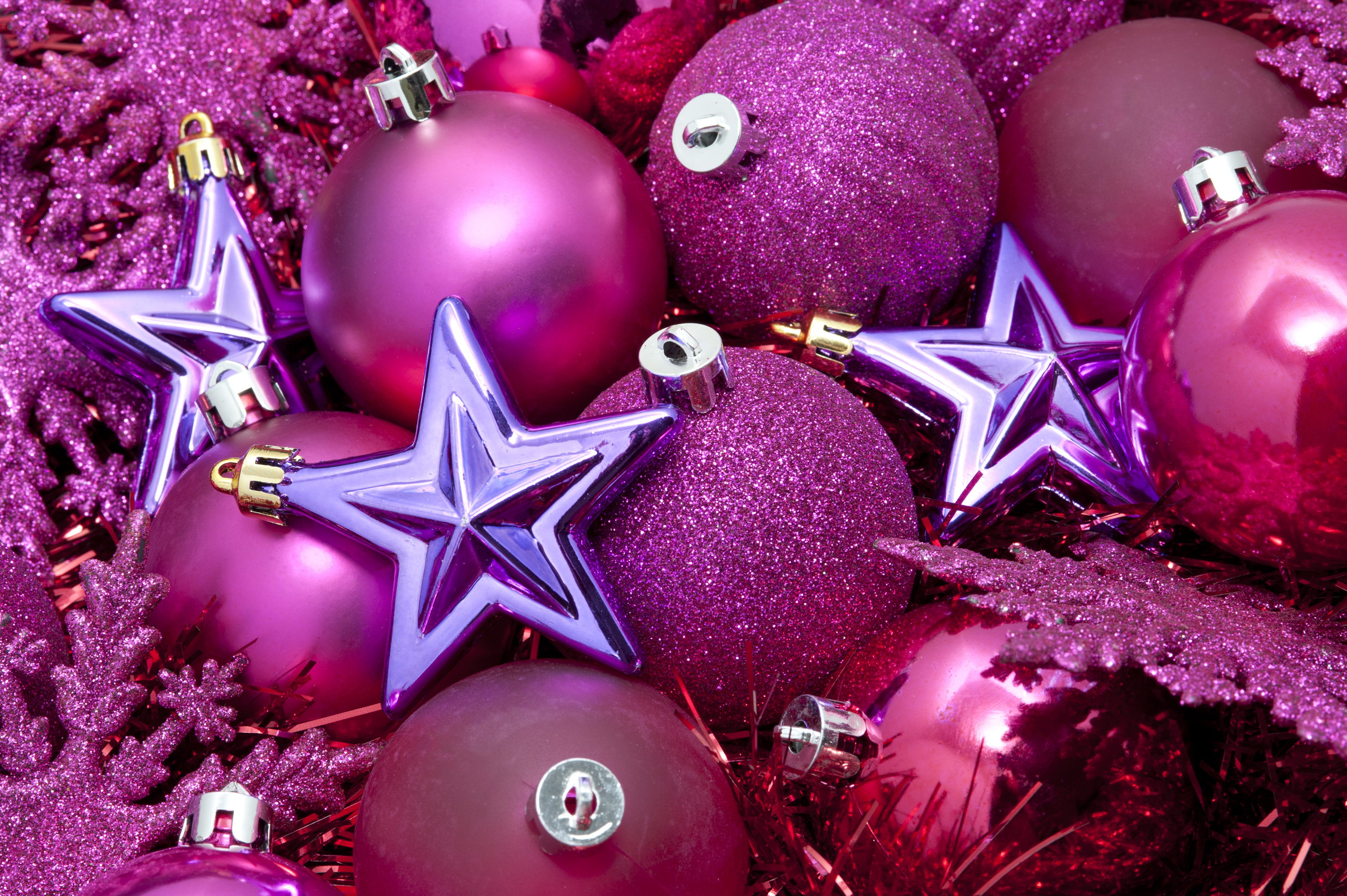 Free stock photo 6824 pink and purple christmas freeimageslive seasonal background with a collection of pink christmas bauble decorations and tinsel topped with purple stars junglespirit