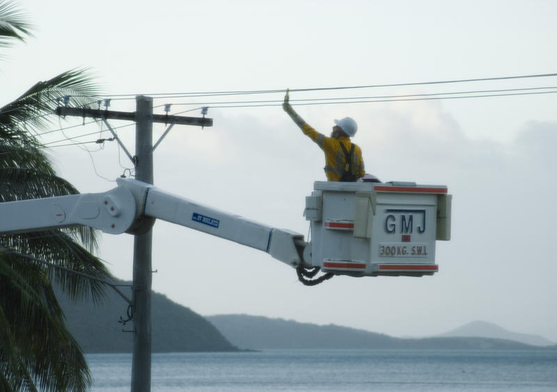 an electrical engineer working on a power lines using a lift platform