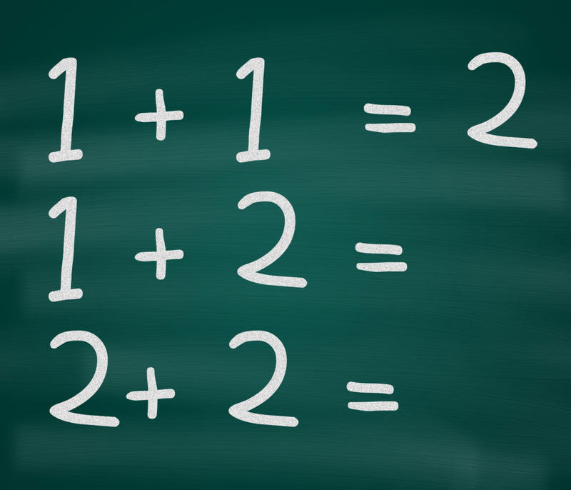 7027   Blackboard with simple sums in chalk